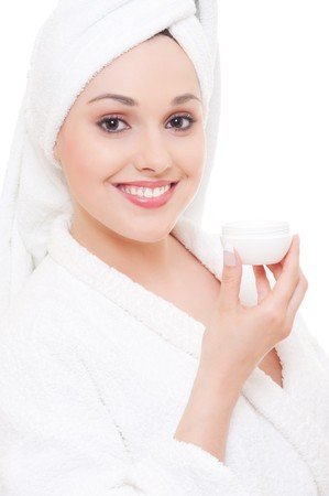 happy young woman with face cream after shower photo