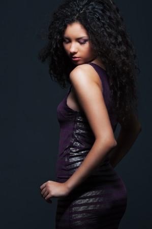 portrait of attractive woman in dress over dark background  Stock Photo - 7827954