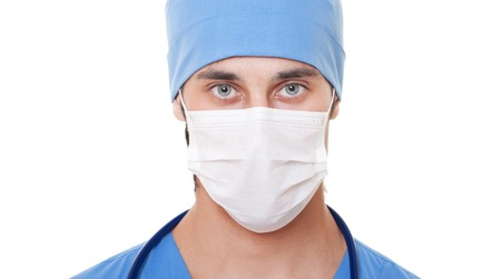 surgeons hat: portrait of doctor in mask and blue uniform. isolated on white background Stock Photo