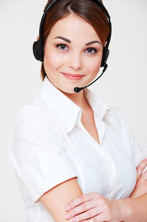 portrait of friendly telephone operator over grey background  Stock Photo - 7827853