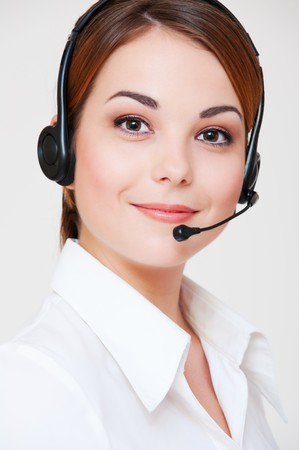 portrait of friendly telephone operator over grey background Stock Photo - 7827851