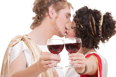 portrait of kissing couple with glasses of wine Stock Photo - 7827863