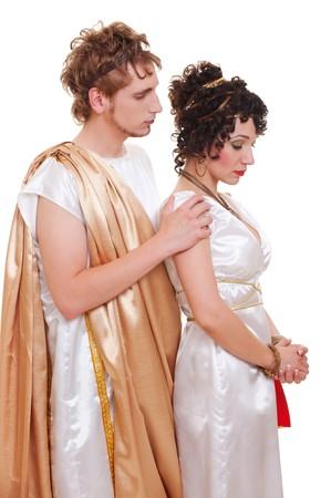 sad couple in Greek style. isolated on white background  photo