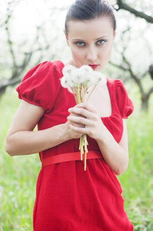 portrait of woman in red dress with posy photo
