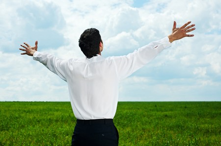 happy businessman in white shirt looking at the sky photo