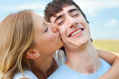 portrait of happy couple in love over blue sky Stock Photo - 8129759