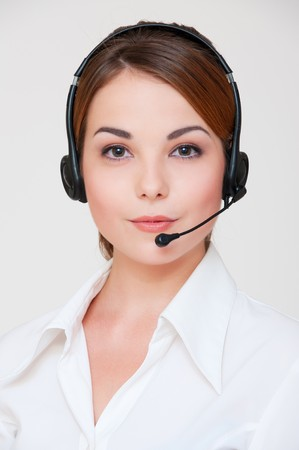 portrait of friendly telephone operator over grey background  Stock Photo - 8129635
