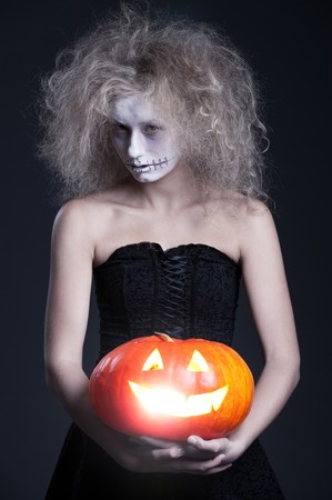 demoniacal: halloween portrait of ghost with orange pumpkin