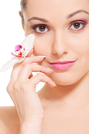 spa face: portrait of lovely young woman with orchid