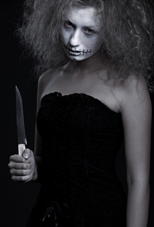 portrait of ghost with knife. halloween theme  photo