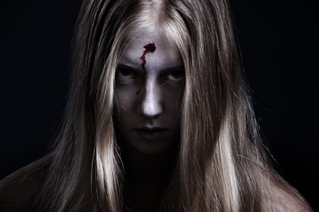 demoniacal: portrait of zombie with wound on forehead. halloween theme