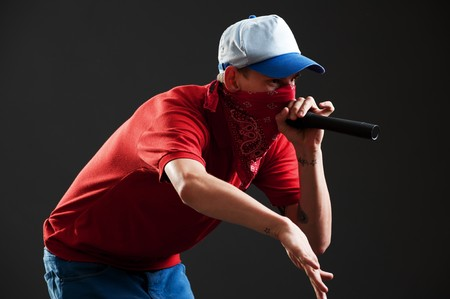 portrait of rapper with microphone over black background photo