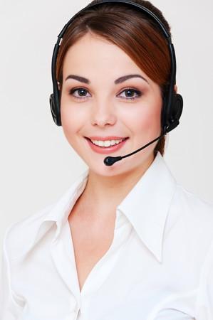 portrait of smiley telephone operator over grey background Stock Photo - 8129649
