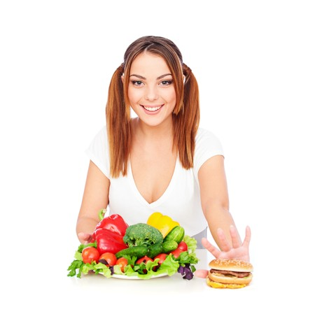 smiley woman with vegetables and burger. isolated on white Stock Photo - 8129615