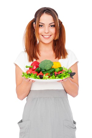 portrait of smiling young woman holding vegetables. isolated on white background  Stock Photo - 8129697