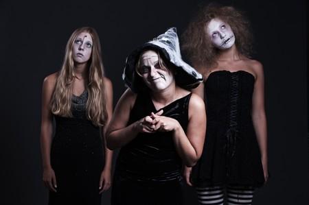 portrait of three halloween personages over dark background  photo