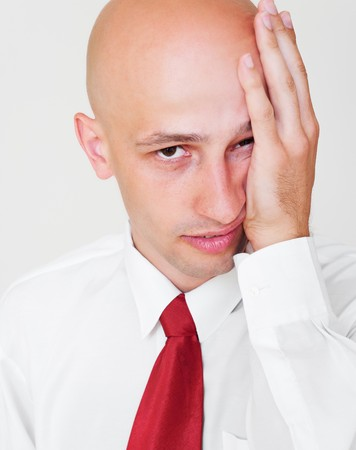weary: portrait of weary businessman over grey background Stock Photo