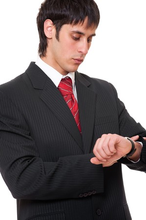 watch over: young businessman looking at watch over white background