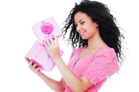 young happy woman with a gift over white background  Stock Photo