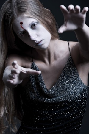 portrait of zombie with wound on forehead. halloween theme photo