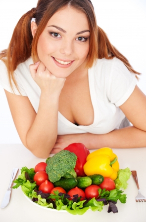 portrait of happy woman with vegetables. isolated on white background Stock Photo - 8654236