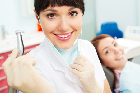 dentist drill: portrait of pretty doctor with dentists drill