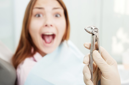 portrait of scared woman at dentists office  Фото со стока