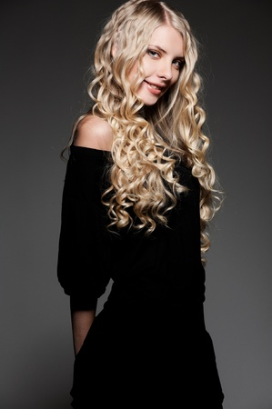 portrait of smiley beautiful woman with long curly hair  photo