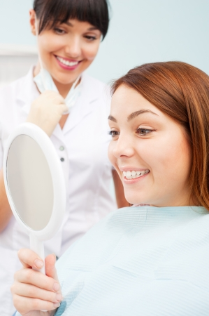 smiley woman looking at her beautiful teeth Stock Photo - 8654310
