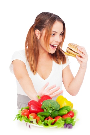 portrait of woman with tasty burger and vegetables. isolated on white Stock Photo - 8653129
