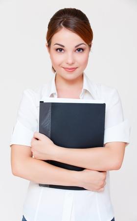 portrait of assured businesswoman with black folder over grey background  photo