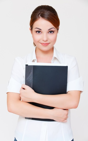 assured: portrait of assured businesswoman with black folder over grey background  Stock Photo
