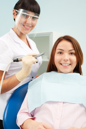 portrait of doctor and patient at dentist's office Stock Photo - 8655260