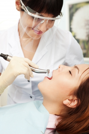 hygienist: portrait of doctor and patient at dentists office  Stock Photo