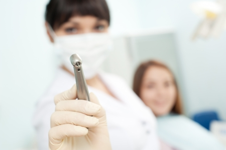 doctor holding dentist's instrument. focus on drill Stock Photo - 8652743