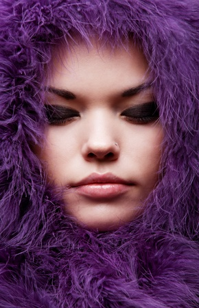 close-up portrait of young woman in violet fur photo