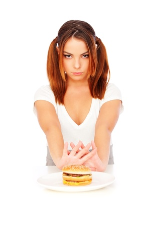 disinclination: portrait of serious woman with burger. isolated on white