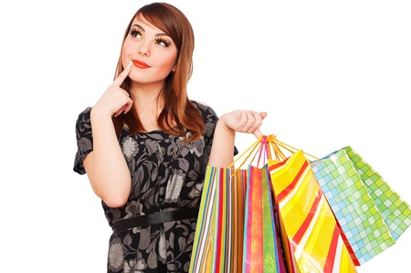portrait of smiley pensive woman with shopping bags photo