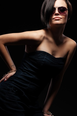 portrait of woman in sunglasses over dark background Stock Photo - 8894021