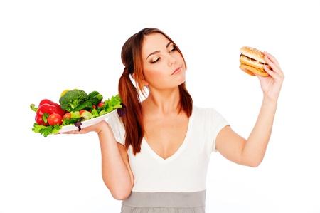 donna pensiero: donna pensando di cibo. isolated on white