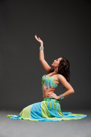 beautiful oriental dancer posing over black background  photo