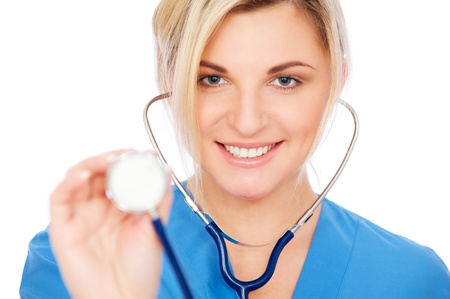 portrait of smiley nurse in blue uniform with stethoscope. isolated on white background  photo