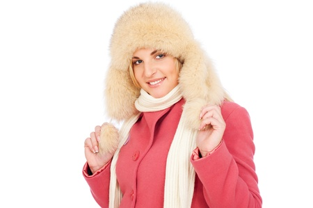 portrait of smiley woman in fur hat. isolated on white background  photo