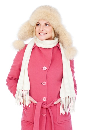 portrait of smiley woman in pink coat and fur hat. isolated on white background  photo
