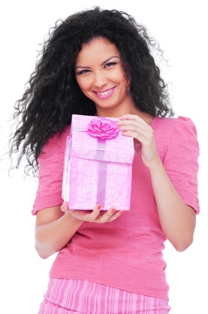 young happy woman with a gift over white background  photo