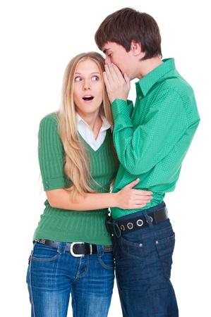 hearsay: amazed girl listening her boyfriend. isolated on white  Stock Photo