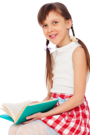 portrait of cute smiley girl with book photo