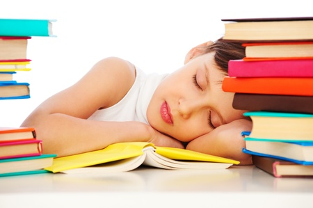 fatigued: portrait of fatigued schoolgirl sleeping on book Stock Photo