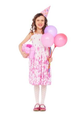 joyous: full-length portrait of joyous girl with balloons over white background