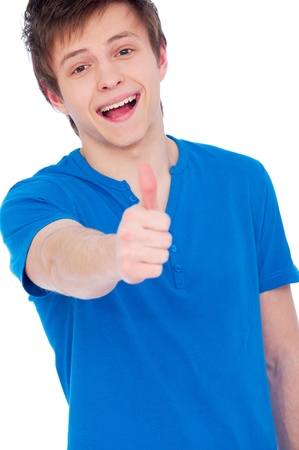 happy young man dressed casually giving thumbs up  photo